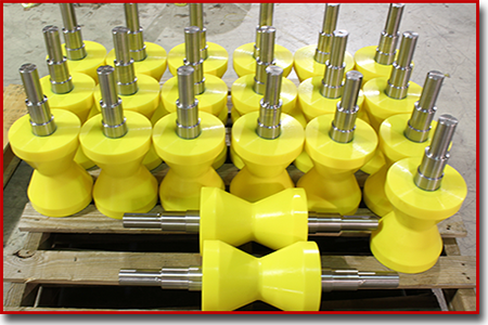 yellow urethane V rollers on a pallet