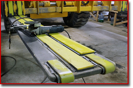 urethane toe guards and steel backed urethane strips on a forklift